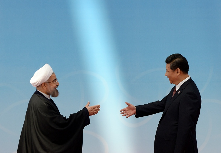 Iran's President Rouhani shakes hands with his Chinese counterpart Xi before the opening ceremony of the CICA summit in Shanghai
